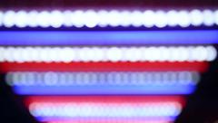 Defocused advertising and street lights Stock Footage