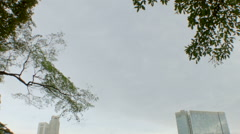 A view of Clarke Quay Central from Fort Canning Park, Singapore Stock Footage