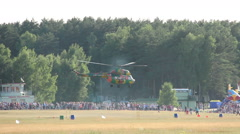 Helicopter is flying at an air show and manufactures landing Stock Footage