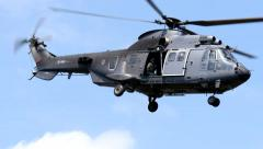 4K Military Apache flying over Stock Footage