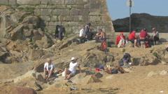 Tourists relaxing near Castelo do Queijo's wall, Porto Stock Footage