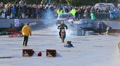 Stunt woman getting run over by motorcycle at stunt show Footage