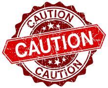 caution red round grunge stamp on white - stock illustration