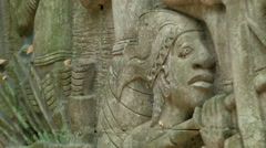 Carvings depicting pre-modern Singapore History at Fort Canning Park Stock Footage