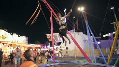 Kid jumping on trampoline Stock Footage