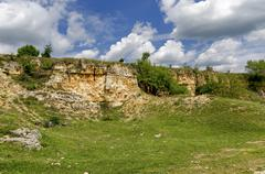 General view toward sedimentary rock in the field Stock Photos