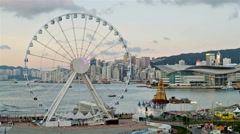 Hong Kong harbour skyline with ferris wheel Stock Footage