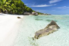 Perfect white beach Anse Pierrot near Source D'Argent in La Digue, Seychelles - stock photo