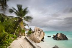 Dark clouds over the beach Anse Source D'Argent in La Digue, Seychelles with  Stock Photos