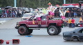 Girls cheerleaders mini skirts jump off Bigfoot car, stunt show HD Footage
