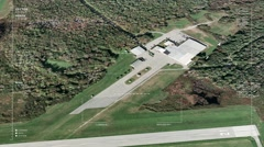 Aerial surveillance flyover of a small airport's runways and outbuilding - stock footage