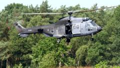 4K Apache flying in the woods - stock footage