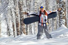 Sport woman going for freeride with snowboard Stock Photos
