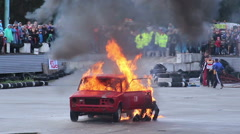 Stock Video Footage of Stuntman escapes burning car, risky fire stunt. Part1of3