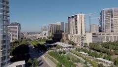 Aerial over sculpture to Dallas skyline and Kylde Warren Park Stock Footage