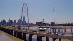 Fly to pedestrian & Margaret Hunt Hill bridges w/Dallas Skyline & Trinity River Stock Footage
