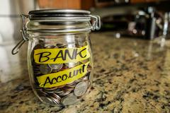 Bank Account Money Jar - stock photo