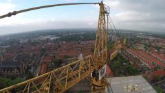 Aerial of tower crane stunt drone fly through and construction site 4k Stock Footage