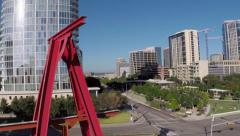 Flyby large art peice to reveal Dallas Skyline & city park Stock Footage