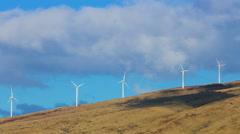 Wind turbines producing clean alternative energy - stock footage