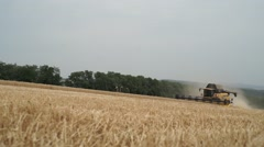 Combine harvester doing its job Stock Footage