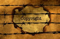 Stock Photo of Copyright concept against barbwire