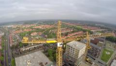 Aerial of yellow tower crane fly around construction site helicopter view 4k Stock Footage