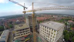 Construction site aerial helicopter view of building tower cranes 4k Stock Footage