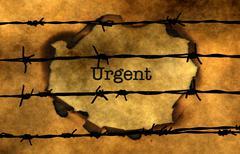 Urgent concept against barbwire Stock Photos