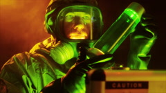 Tech with HUD looking at a biohazard sample - stock footage