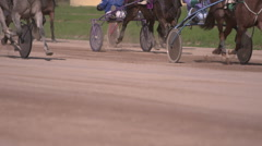 Horse racing close-up of the wagons and the hooves of a running horse Stock Footage