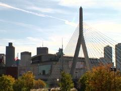 Boston Zakim bridge in front of Boston Garden arena fall colors Stock Footage