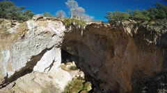 Aerial footage of a natural bridge in Tonto Bridge State Park in Arizona Stock Footage