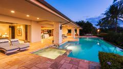 Luxury Home with Pool at Sunset Stock Photos