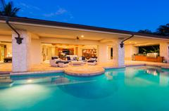 Luxury Home with Pool at Sunset - stock photo