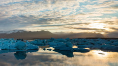Amazing Time Lapse of Drifting Icebergs and the Sunrise. - stock footage
