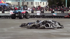 Monster truck easily runs over pile of junk cars, Bigfoot - stock footage