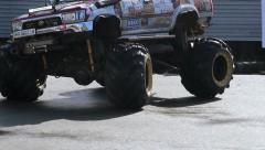 Monster truck roaring, circling, showing off power. With sound Stock Footage