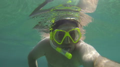 Man swimming diving snorkeling scuba dive mask POV footage 3 Stock Footage