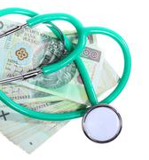cost of health care: stethoscope on polish money - stock photo