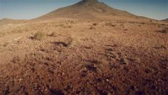 Aerial view of a dry terrain on desert Stock Footage
