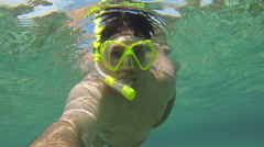 Man swimming diving snorkeling scuba dive mask POV footage 4 Stock Footage