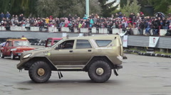 Huge off-road custom truck drifting in front of thrilled crowd Stock Footage