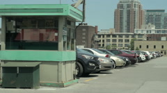 Parking lot with toll booth in foreground Stock Footage