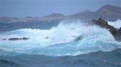 SLOW MOTION: Angry sea in Atlantic ocean splashing into rocks Stock Footage