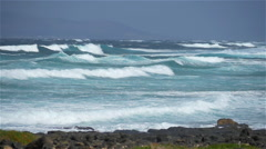 SLOW MOTION: Waves in rough ocean gliding towards the coast - stock footage
