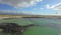 AERIAL: Kitesurfers kiting in big beautiful lagoon on sunny day - stock footage
