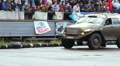 Closeup of huge off-road truck drifting, big wheels, power HD Footage