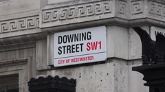 Street sign (in 4K) for Downing Street, London, UK. Stock Footage