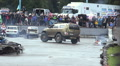 Bigfoot custom monster truck drifting at arena, crowd watching HD Footage